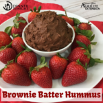 Brownie Batter Hummus recipe surrounded by fresh washed strawberries for dipping.